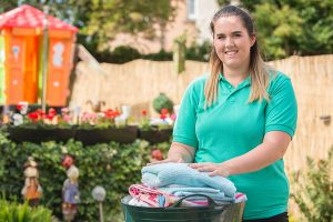 A LifeCare carer helping an older person in Edinburgh with their laundry. Help at Home services.
