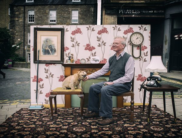 LifeCare Edinburgh supporting and empowering the lives of the elderly at home. Image of an elderly man and his dog at home.