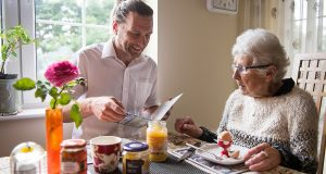 A LifeCare Carer helping a dementia client at home