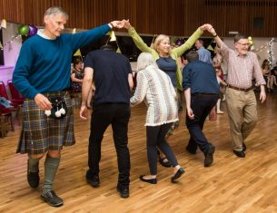 Dancing at celebration in George Young Hall, LifeCare Centre Edinburgh